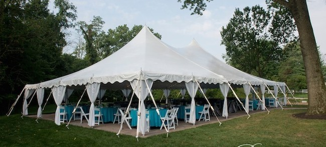 Cincinnati-Wedding-Tent-Rental_40x60-Pole-Tent-with-drapes-660x300.jpg