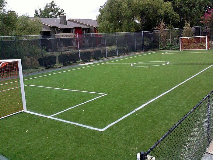 Artificial turf football field installation.jpg