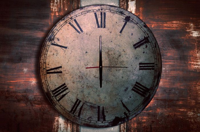 antique-clocks-on-the-old-wall-P7CNBDG.jpg